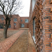 W house - brick wall © Iwan Baan